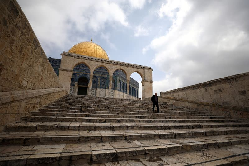 FILE PHOTO: A man walks in front of the Dome of the Rock in Jerusalem's Old City