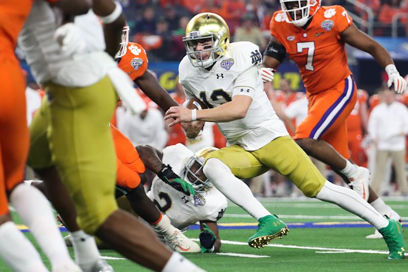 Dec 29, 2018; Arlington, TX, United States; Notre Dame Fighting Irish quarterback Ian Book (12) runs the ball during the first quarter in the 2018 Cotton Bowl college football playoff semifinal game against the Clemson Tigers at AT&T Stadium. Mandatory Credit: Kevin Jairaj-USA TODAY Sports