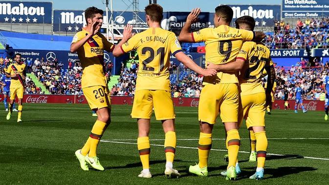 Luis Suarez mencetak satu gol sekaligus membantu Barcelona menang 2-0 atas Getafe pada laga pekan ketujuh La Liga Spanyol, di Coliseum Alfonso Perez, Sabtu (28/9/2019) malam WIB. (AFP/OSCAR DEL POZO)