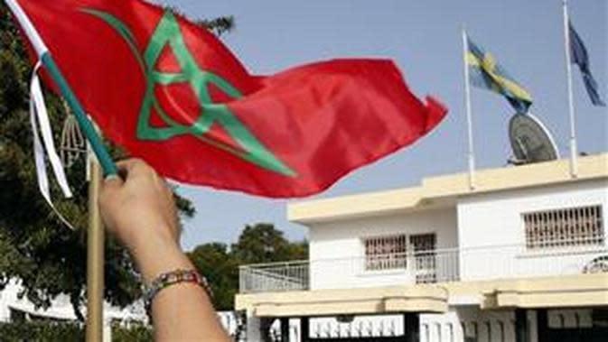 Ilustrasi bendera Maroko. (Source: AP Photo/Abdeljalil Bounhar)