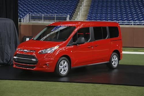 FILE - In this Dec. 14, 2012 file photo, the 2014 Ford Transit Connect Wagon is displayed at Ford Field in Detroit. After a seven-year hiatus, Ford gets back into the minivan market with the Transit Connect Wagon, which is expected to go on sale at the end of 2013. The vehicle, which is based on Ford's Transit Connect commercial van, has the van's high roof and industrial look but the tapered nose and trapezoid grille of Ford's cars. (AP Photo/Carlos Osorio, File)
