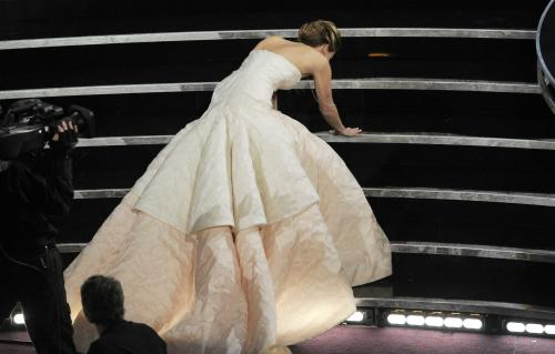 "FILE - This Feb. 24, 2013 photo shows Jennifer Lawrence stumbling as she walks to the stage to accept the award for best actress in a leading role for ""Silver Linings Playbook"" during the Oscars at the Dolby Theatre in Los Angeles. (Photo by Chris Pizzello/Invision/AP, File)"