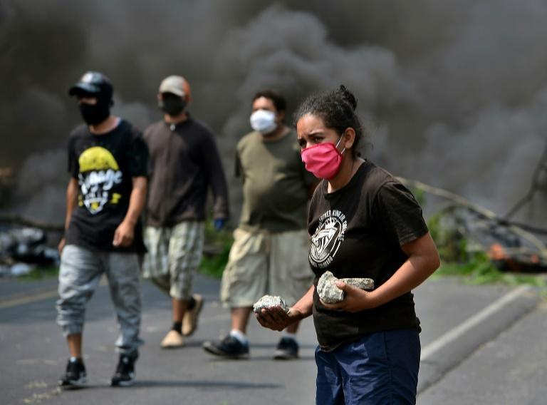 People take part in a protest against the burial of COVID-19 victims near their communities on the Tegucigalpa-Olancho highway
