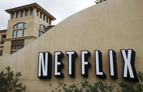 In this Oct. 10, 2011, file photo, the exterior of Netflix headquarters is seen in Los Gatos, Calif. Netflix stock, on Thursday, Jan. 24, 2013, is on its way to its biggest one-day gain since the video subscription service went public more than a decade ago. (AP Photo/Paul Sakuma, file)
