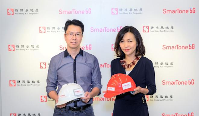 Chan Ka-ming, project manager at Yee Fai Construction Company, the construction arm of Sun Hung Kai Properties, and Anna Yip, chief executive at SmarTone, cooperated to put the SmartWorks system into use. Photo: Handout