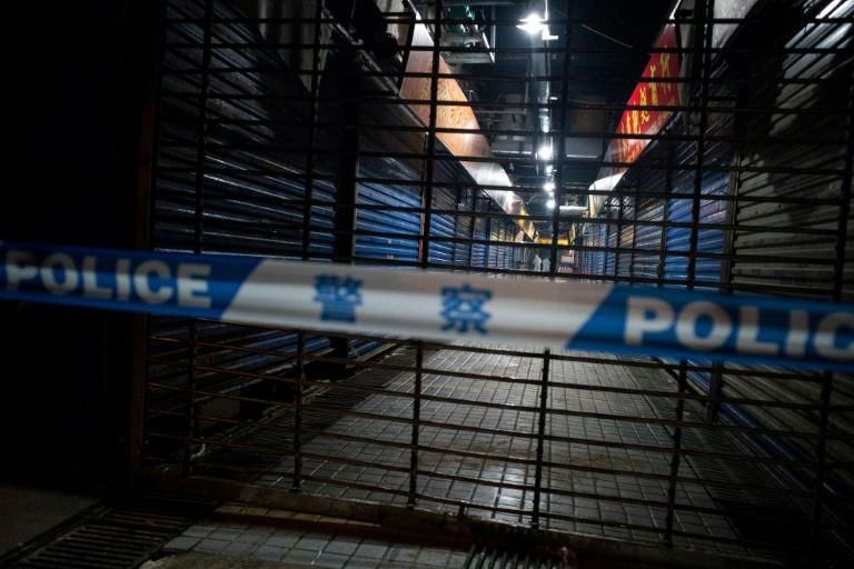 A Hygiene Emergency Response Team searches the closed Huanan Seafood Wholesale Market in Wuhan in January 2020
