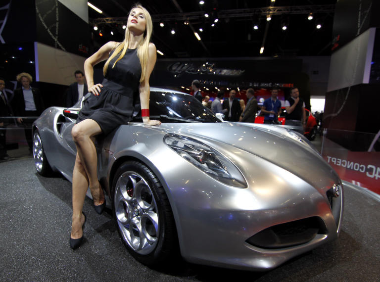 A hostess sits on the Alfa Romea Concept Car 4C during the press day of the Frankfurt Auto Show IAA in Frankfurt, Germany, Tuesday, Sept. 13, 2011. The fair opens its doors to the public Sept. 15 to Sept. 25, 2011. (AP Photo/dapd, Roberto Pfeil)