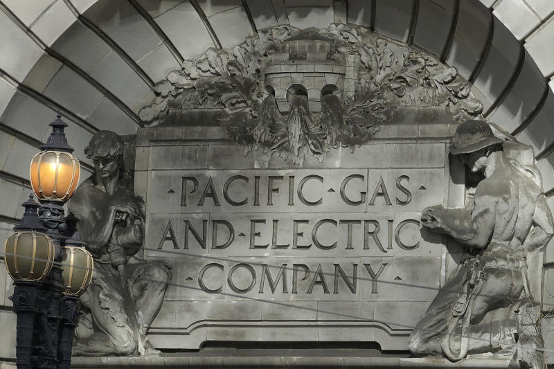 FILE - In this Oct. 10, 2019, file photo, a Pacific Gas and Electric sign sits in the exterior of a PG&E building in San Francisco. California power regulators are weighing a recommendation to back off plans to fine PG&E an additional $462 million for igniting a series of Northern California 2018 deadly wildfires rather than risk that the harsher punishment will scuttle the utility's plan to emerge from bankruptcy protection. The state's Public Utilities Commission is mulling whether to pare the penalties PG&E faces as the result of a proposed revision floated by one of agency's five commissioners, Clifford Rechtschaffen. The document was made public Monday, March 30, 2020. (AP Photo/Jeff Chiu, File)