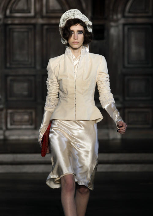 FILE - This Feb. 16, 2012 file photo shows an outfit from the L'Wren Scott Fall 2012 collection being modeled during Fashion Week, in New York. Scott was found dead Monday, March 17, 2014, in Manhattan of a possible suicide. (AP Photo/Richard Drew, File)