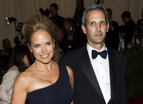 "FILE - In this May 6, 2013 file photo, TV personality Katie Couric, left, and John Molner attend The Metropolitan Museum of Art's Costume Institute benefit celebrating ""PUNK: Chaos to Couture"" in New York. Couric is engaged to her financier boyfriend John Molner. Couric's spokesman Matthew Hiltzik confirmed the engagement Tuesday morning following a report by People magazine. Molner gave 56-year-old Couric, the former host of ""Today,"" a diamond ring over the weekend in East Hampton. (Photo by Charles Sykes/Invision/AP, File)"