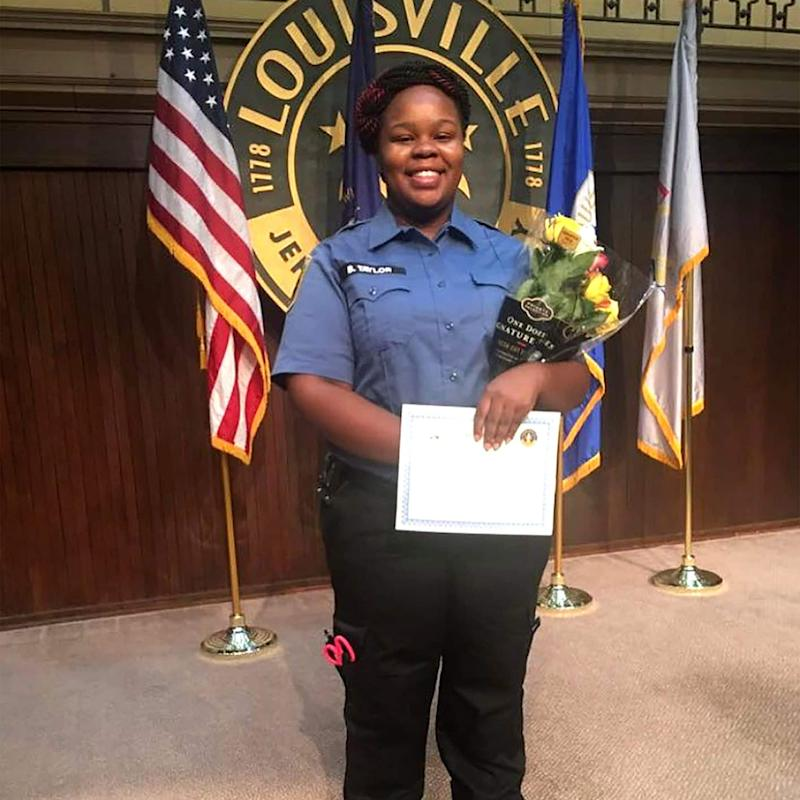 Breonna Taylor posing during a graduation ceremony in Louisville Kentucky. She was shot dead by police in her home in March - Family handout