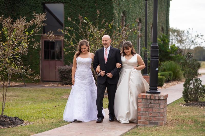 Nicole Halbert shared images of her daughters dressed as brides dancing with their terminally-ill father. Two (Chubbycheek Photography/Supplied) https://www.facebook.com/1468195153/posts/10220740104440314?sfns=mo