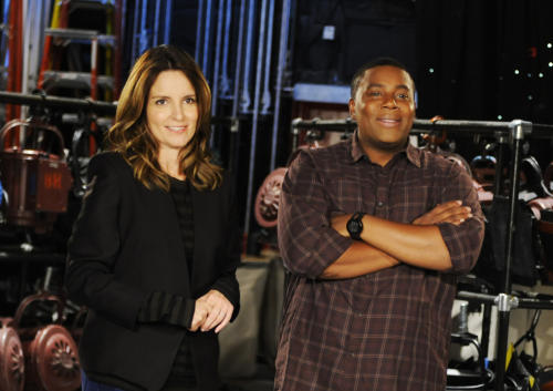 "This Sept. 24, 2013 photo released by NBC shows Tina Fey, left, and Kenan Thompson on the set of ""Saturday Night Live,"" in New York. Fey, a former cast member, will host the season opener of the popular late night sketch comedy show on Sept. 28. (AP Photo/NBC, Dana Edelson)"