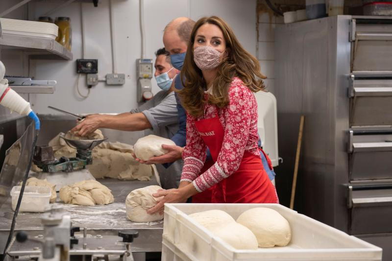 The couple turned their hand to making bagels at East London's Beigel Bake Brick Lane Bakery. (Getty Images)