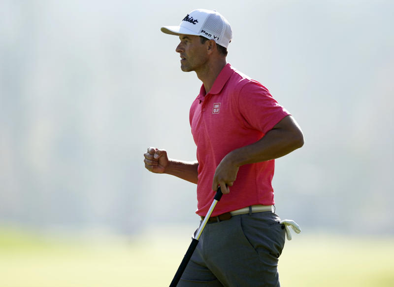 Adam Scott, of Australia, reacts after making a birdie putt on the 17th hole during the final round of the Genesis Invitational golf tournament at Riviera Country Club, Sunday, Feb. 16, 2020, in the Pacific Palisades area of Los Angeles. (AP Photo/Ryan Kang)