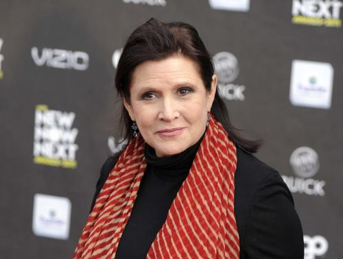 "FILE - This April 7, 2011 file photo shows Carrie Fisher at the 2011 NewNowNext Awards in Los Angeles. Fisher says she's coming back as Princess Leia for the new ""Star Wars"" films. The actress confirmed that she'll return as the iconic character in an interview posted Wednesday, March 6, 2013, with Florida's Palm Beach Illustrated. Casting for the films has yet to be announced, but Fisher answered a simple ""yes"" when asked if she would be reprising Leia. (AP Photo/Chris Pizzello, file)"