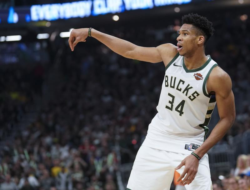 Milwaukee Bucks' Giannis Antetokounmpo watches a shot during the first half of Game 5 of the NBA Eastern Conference basketball playoff finals against the Toronto Raptors Thursday, May 23, 2019, in Milwaukee. (AP Photo/Morry Gash)