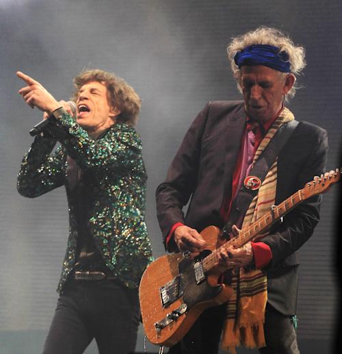 Mick Jagger and Keith Richards of The Rolling Stones perform at Glastonbury, England on Saturday, June 29, 2013. Thousands are to enjoy the three day festival that started on Friday, June 28, 2013 with headliners Arctic Monkeys, the Rolling Stones and Mumford and Sons. (Photo by Jim Ross/Invision/AP)