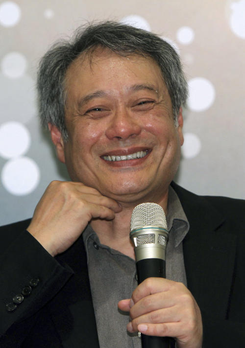 Taiwanese director Ang Lee smiles while speaking during a press conference in Taipei, Taiwan, Thursday, May 9, 2013. The academy award winning director said Thursday that modesty and diligence have been the keys to his success in penetrating the foreign cultures that have framed the backgrounds for many of his most notable films. (AP Photo/Chiang Ying-ying)