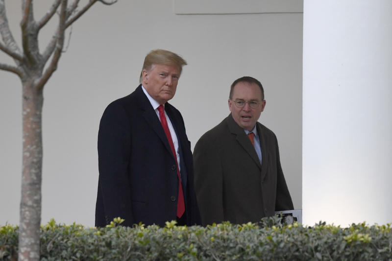 FILE - In this Jan. 13, 2020. file photo, President Donald Trump, left, and acting White House chief of staff Mick Mulvaney, right, walk along the colonnade of the White House in Washington. The federal government's watchdog agency says a White House office violated federal law in withholding security assistance to Ukraine aid. The Government Accountability Office said Thursday the White House Office of Management and Budget violated the law in holding up the assistance. (AP Photo/Susan Walsh, File)