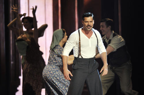 "Ricky Martin performs with the cast of ""Evita"" at the 66th Annual Tony Awards on Sunday June 10, 2012, in New York. (Photo by Charles Sykes /Invision/AP)"