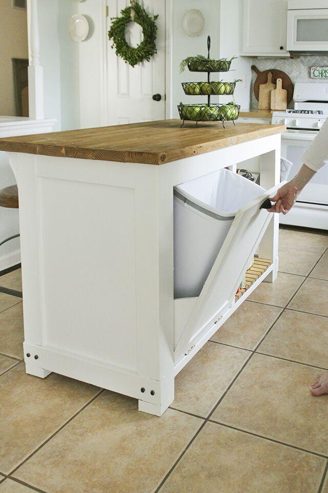 """<p>Hide your trash with this DIY kitchen island complete with a built-in, pull-out trash can. For added convenience, this island also features counter seating, wood slat shelves, and hooks for hanging kitchen towels and oven mitts.  </p><p><strong>Get the tutorial at <a href=""""https://www.shadesofblueinteriors.com/diy-kitchen-island-trash-storage/"""" target=""""_blank"""">Shades of Blue Interiors</a>.</strong> </p><p><a class=""""body-btn-link"""" href=""""https://www.amazon.com/Wallniture-Gourmet-Kitchen-Mounted-Wrought/dp/B01MCVT74G/?tag=syn-yahoo-20&ascsubtag=%5Bartid%7C10050.g.31102255%5Bsrc%7Cyahoo-us"""" target=""""_blank"""">SHOP KITCHEN RAILS WITH HOOKS</a></p>"""