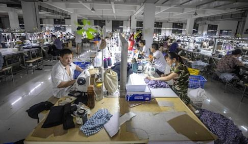 Many of China's migrant workers rely on overtime work to supplment their wages. Photo: EPA-EFE