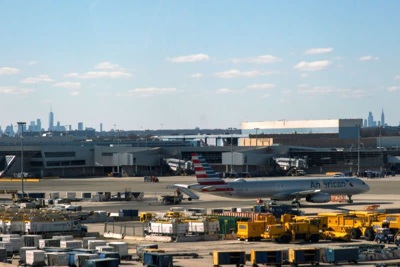 An American airline plane is seen at the tarmac after the Federal Aviation Administration (FAA) temporarily halted flights arriving at New York City airports due to coronavirus disease (COVID-19) in New York