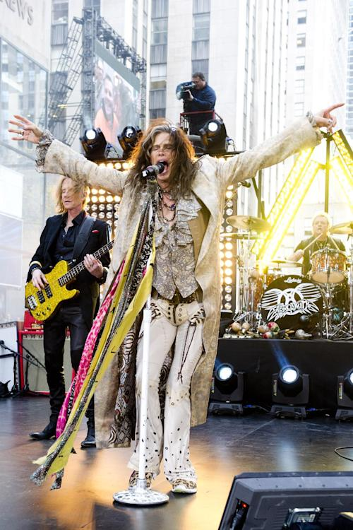 """FILE - In this Nov. 2, 2012 file photo, Steven Tyler of Aerosmith performs on NBC's """"Today"""" show in New York. The former """"American Idol"""" judge Tyler responded on Tuesday, Nov. 27, 2012, to Nicki Minaj's claim that he's a racist during an interview with the Canadian entertainment news program """"eTalk"""" following Twitter comments made by Minaj, an """"Idol"""" judge this season. (Photo by Charles Sykes/Invision/AP, File)"""