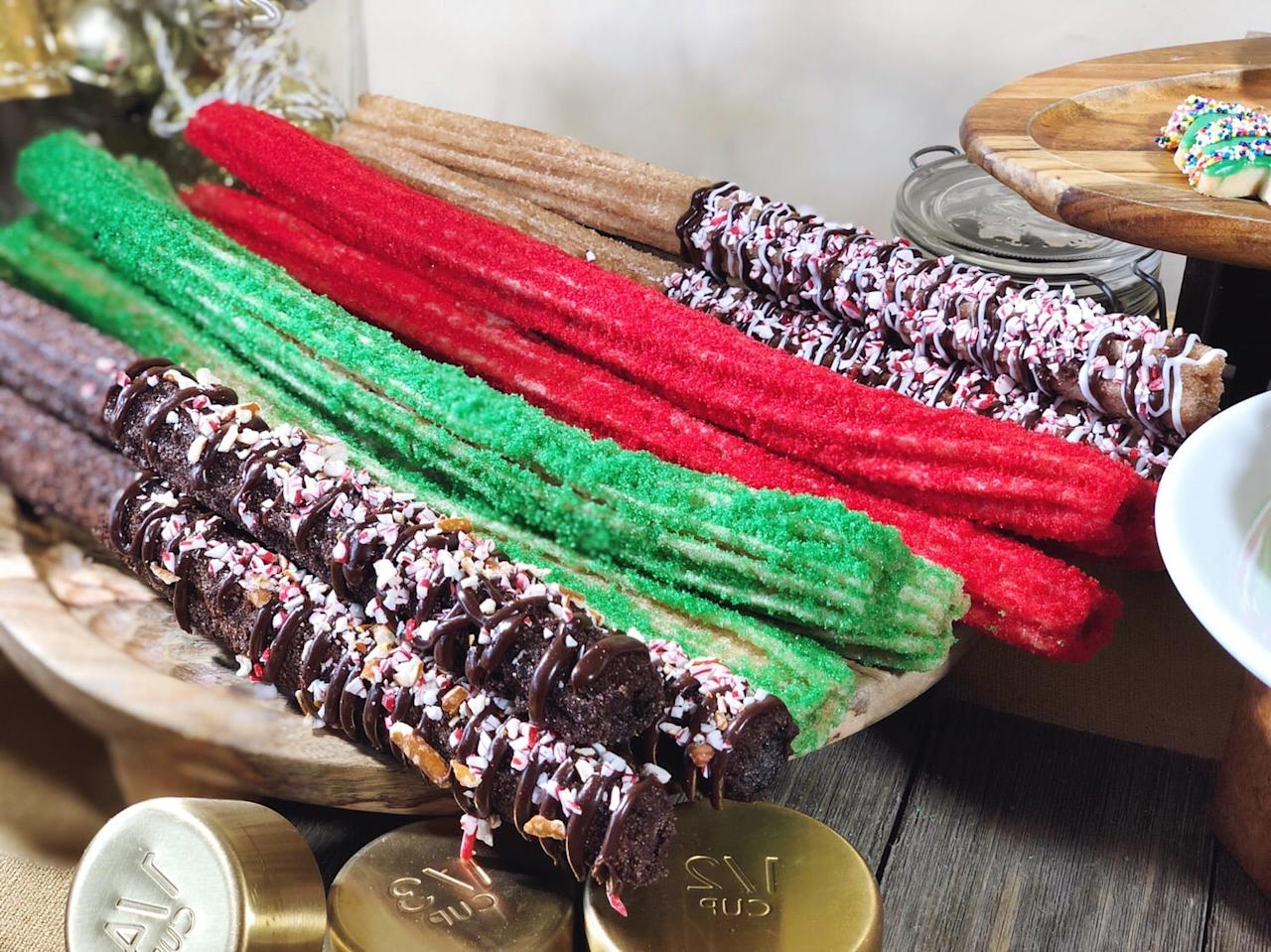 <p>Here are the new chocolate churros pictured with the red and green churros (which can be found near Goofy's Sky School in California Adventure) and the peppermint churros with crushed candy canes and chocolate and vanilla icing (which can be found near the Redwood Creek Challenge Trail).</p>