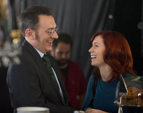 "This undated image released by CBS shows Michael Emerson, left, and Carrie Preston in a scene from ""Person of Interest."" Emerson has played a serial killer, a mysterious, villainous Island leader and currently stars as a billionaire computer genius on ""Person of Interest."" But he says playing the romantic interest for his real life wife has been his most unsettling role. Emerson plays the off-beat Harold Finch in ""Person of Interest,"" which airs Thursdays at 10 p.m. Eastern. His wife Carrie Preston has a recurring role as Finch's former fiance, who believes he is dead. (AP Photo/CBS, John Paul Filo)"