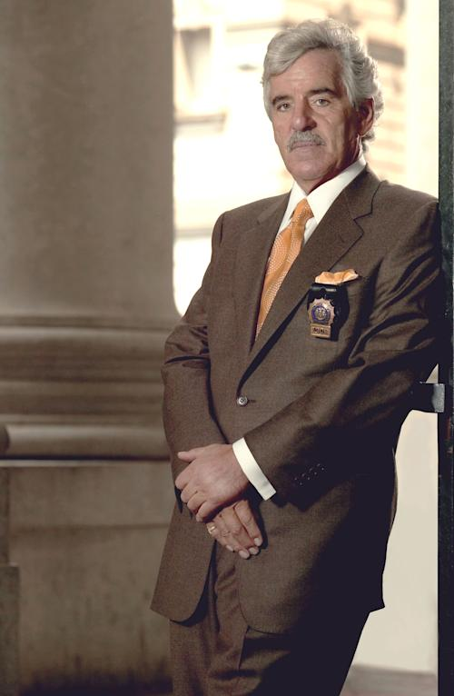"""FILE - This 2004 file image released by NBC shows actor Dennis Farina in character as Police Detective Joe Fontana on NBC's """"Law & Order."""" Farina died suddenly on Monday, July 22, 2013, in Scottsdale, AZriz., after suffering a blood clot in his lung. He was 69. (AP Photo/NBC, Paul Drinkwater, File)"""