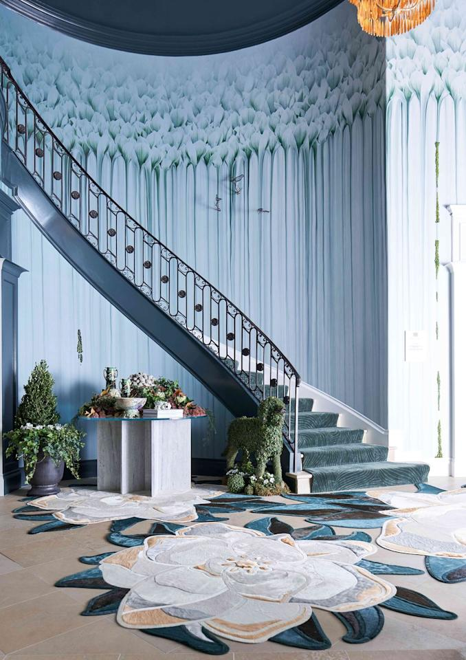 "<p>The foyer is where you get your first impression of any home, so Lauren Rottet of <a href=""https://www.rottetstudio.com/"" target=""_blank"">Rottet Studio</a> tried to mirror the verdant hues of nature and juxtapose them with cutting-edge contemporary furnishings. Magnolia-shaped rugs by <a href=""https://kylebunting.com/?utm_source=google&utm_medium=cpc&utm_campaign=brand&gclid=Cj0KCQjwk8b7BRCaARIsAARRTL5bpOsDFXq2ho8nQgd5HrRHSVdBxBkA8578CfsB9JiWWrGZ58PELWgaAvGWEALw_wcB"" target=""_blank"">Kyle Bunting</a> and <a href=""http://troveline.com/"" target=""_blank"">Trove</a>'s custom wallpaper illustrating a forest of magnolias give off the feeling of a Southern garden. Above all, Rottet's goal was for visitors to walk in and instantly feel calm and relaxed during these trying times. </p>"
