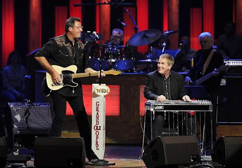 "This Saturday, July 27, 2013 photo shows Vince Gill, left, and Paul Franklin performing at the Grand Ole Opry in Nashville, Tenn. Gill and Franklin released their latest album ""Bakersfield,"" on July 30. (Photo by Donn Jones/Invision/AP)"