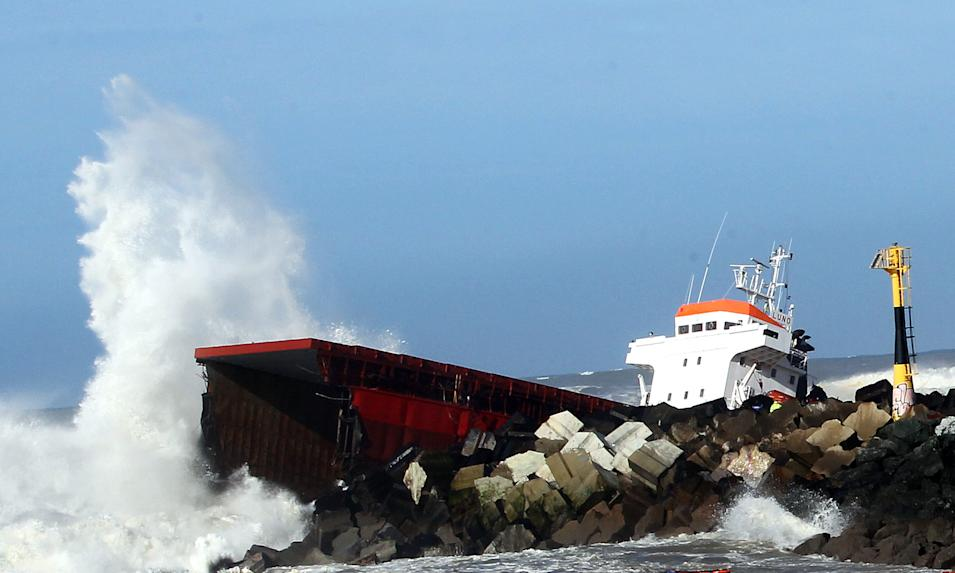 "Waves knock against the wreck of the Spanish cargo ship ""Luno"" that slammed into a jetty in choppy Atlantic Ocean waters and broke in two, off Anglet, southwestern France, Wednesday, Feb. 5, 2014. The ship had been heading to a nearby port to load up with cargo when its engine failed and the rough waves carried it into the jetty. (AP Photo/Bob Edme)"