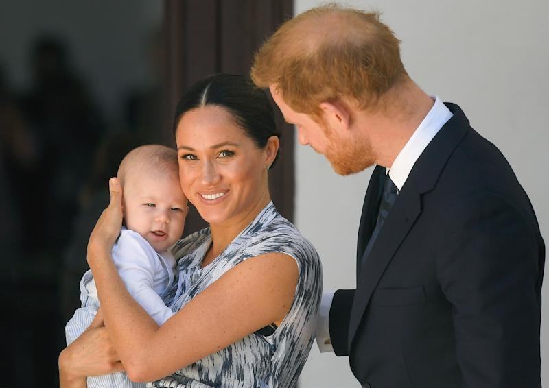 A photo of Meghan Markle holding baby Archie alongside Prince Harry in South Africa.
