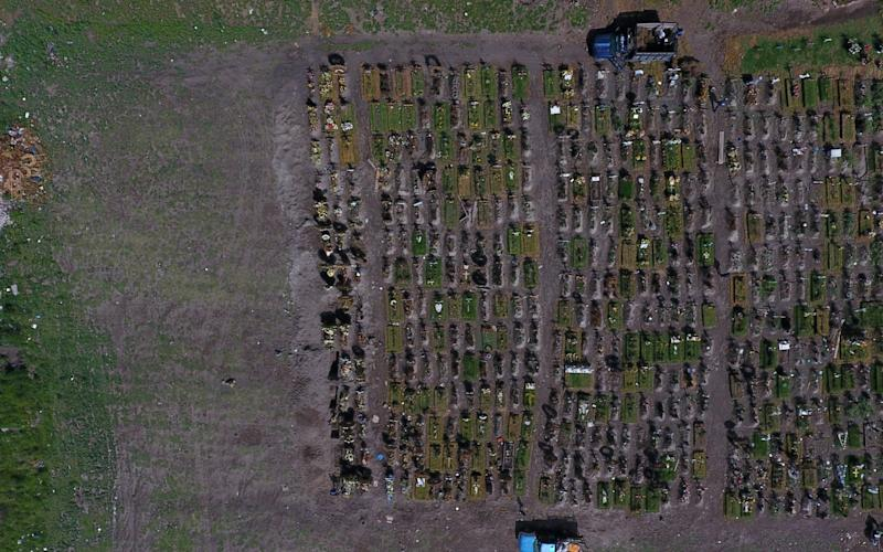 Recent graves expand across a section of the Municipal Cemetery of Valle de Chalco amid the ongoing coronavirus pandemic, on the outskirts of Mexico City - Virus Outbreak Mexico/AP