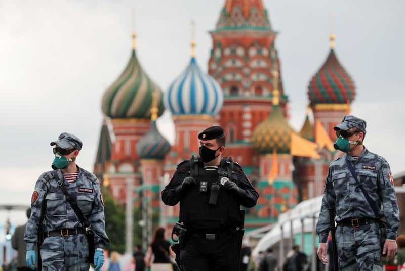 Russian law enforcement officers work at the annual Red Square Book Fair in central Moscow