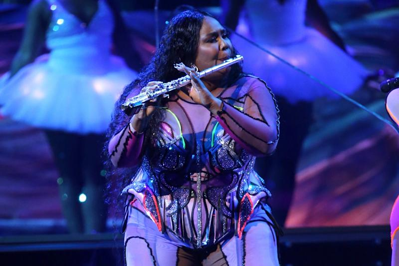 Lizzo breaking out the flute at the 62nd annual Grammy Awards: Invision/AP