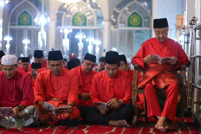 Tun Dr Mahathir Mohamad sits on a chair during the prayer and yasin recitation event commemmorating Parti Pribumi Bersatu Malaysia's third anniversary, September 12, 2019.
