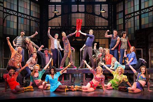 "This theater image released by The O+M Company shows the cast during a performance of the musical ""Kinky Boots."" The Tony Award musical winner with infectious songs by Cyndi Lauper and a sloppy kiss of a story by Harvey Fierstein is unabashedly sentimental, with a classic message of acceptance. Billy Porter, as the drag queen at its heart, can make tears fall down your cheeks and he's sticking with the show into 2014. (AP Photo/The O+M Company, Matthew Murphy)"