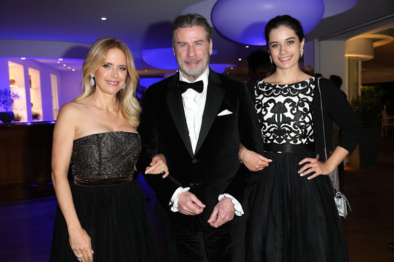 John Travolta and Kelly Preston (L) and daughter Ella Bleu Travolta (R) during the party in Honour of John Travolta's receipt of the Inaugural Variety Cinema Icon Award during the 71st annual Cannes Film Festival at Hotel du Cap-Eden-Roc on May 15, 2018 in Cap d'Antibes, France. (Photo by Gisela Schober/Getty Images)