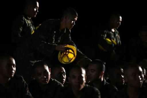 Thai rescuers fed a kilometres-long air pipe into the cave where 12 boys and their football coach are trapped to restore oxygen levels in the chamber where the team was sheltering with medics and divers