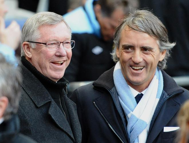 Manchester United Manager Alex Ferguson (L) And Manchester City's Italian Manager Roberto Mancini Speak   RESTRICTED TO AFP/Getty Images