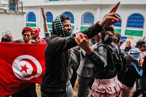 FILE. - This March 1, 2013 file photo shows Tunisian students performing a Harlem Shake, in front of the education ministry in Tunis, Tunisia. The YouTube phenomenon of the Harlem Shake has swept Tunisian youth, provoking attacks by conservative Muslims, condemnation by the education minister and hundreds of new copycat videos online. (AP Photo/Amine Landoulsi, File)