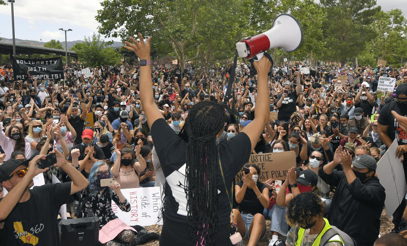 A demonstrator speaks during a protest, Saturday, June 6, 2020, in Simi Valley, Calif. over the death of George Floyd. Protests continue throughout the country over the death of Floyd, a black man who died after being restrained by Minneapolis police officers on May 25.  (AP Photo/Mark J. Terrill)