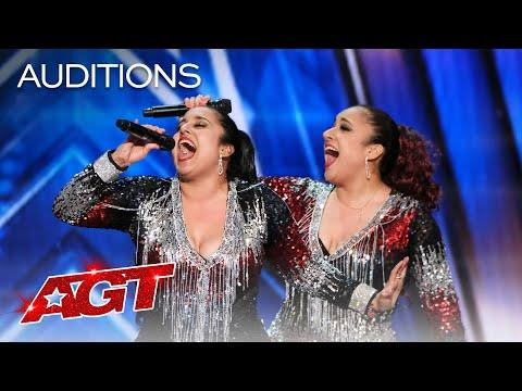 """<p>From the moment these twin sisters began singing """"It's Raining Men"""" by <strong>The Weather Girls</strong>, the judges were sold. Their vocals, paired with their spirited enthusiasm, made for an amazing audition. It'll be exciting to see them harmonize in the live shows.</p><p><a href=""""https://www.youtube.com/watch?v=CW077YsJBQ0"""">See the original post on Youtube</a></p>"""