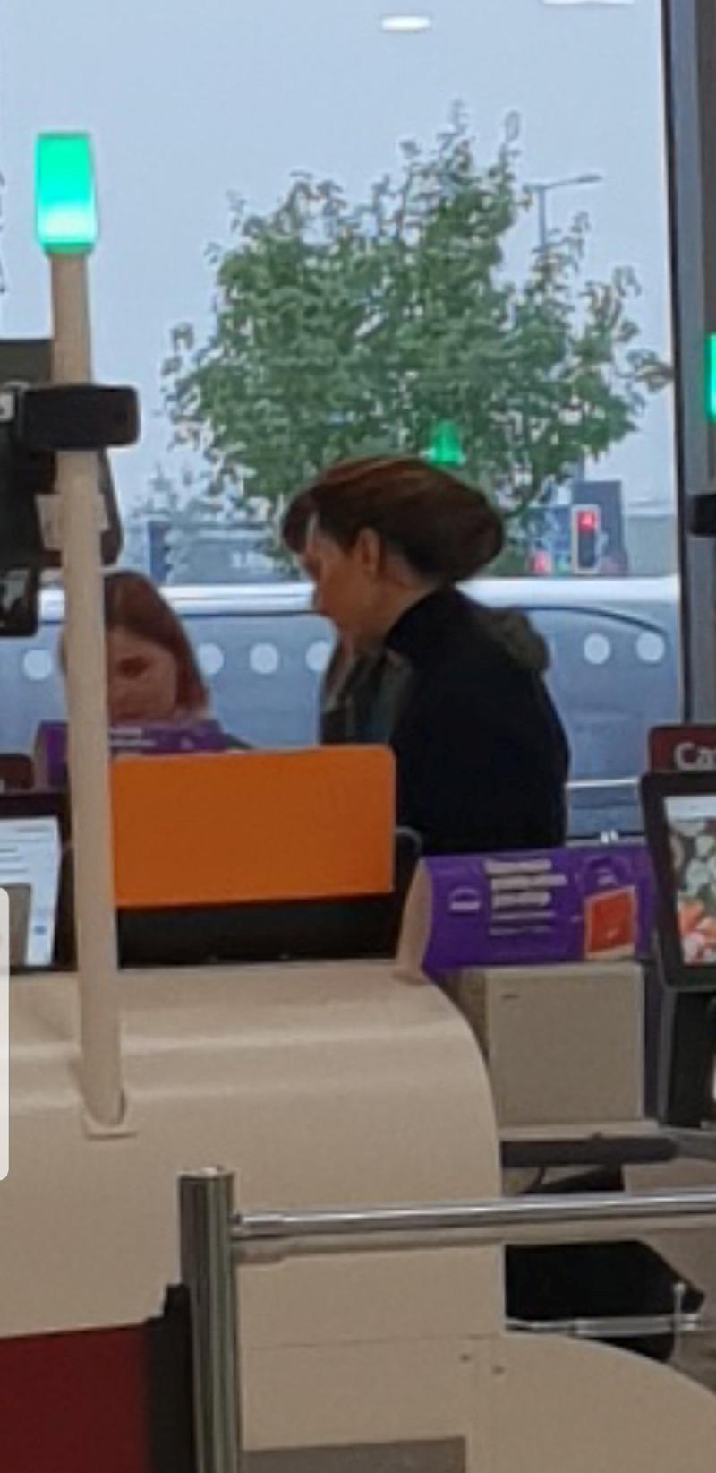 A photo of the Duchess of Cambridge at Sainsbury's supermarket in Norfolk, UK, buying Halloween 'bits' with son Prince George and daughter Princess Charlotte