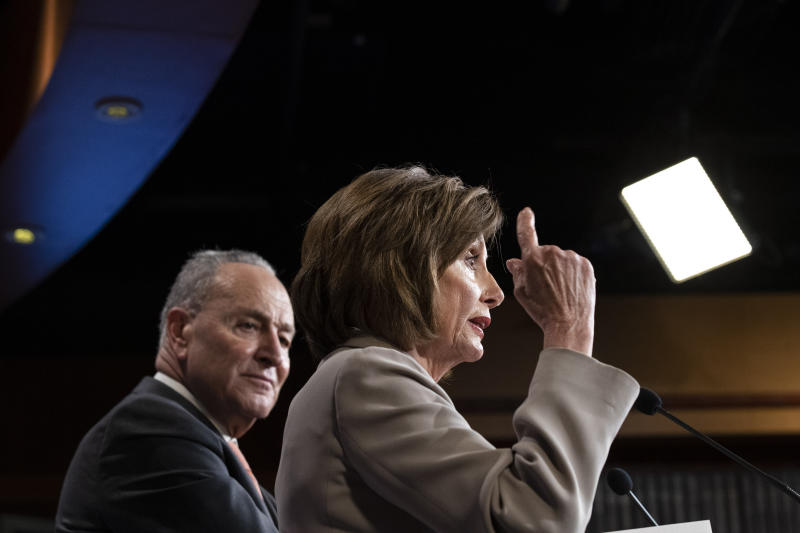 House Speaker Nancy Pelosi of Calif., right, joined by Senate Minority Leader Chuck Schumer of N.Y., speaks during a news conference, on Capitol Hill, Tuesday, Feb.11, 2020, in Washington. (AP Photo/Alex Brandon)