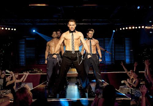 """This film image released by Warner Bros. shows, from left, Adam Rodriguez, Kevin Nash, Channing Tatum, and Matt Bomer in a scene from """"Magic Mike."""" Matthew McConaughey, Channing Tatum, Alex Pettyfer, Joe Manganiello and Matt Bomer play fire men, cops and other exaggerated versions of hyper-masculine characters in the Steven Soderbergh film, and they say preparing for their parts and performing nearly nude for the dozens of female extras who populated the fake Club Xquisite gave the actors insight into women's grooming, undergarments and approach to carnal fantasy. (AP Photo/Warner Bros., Claudette Barius)"""